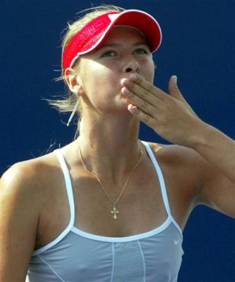 Russia's Maria Sharapova gestures a kiss to the crowd to show her appreciation after defeating compatriot Tatiana Panova during a second round match in the China Open in Beijing, China, Wednesday, Sept. 22, 2004. Sharapova beat Panova 6-1, 6-1. (AP Photo/Ng Han Guan)